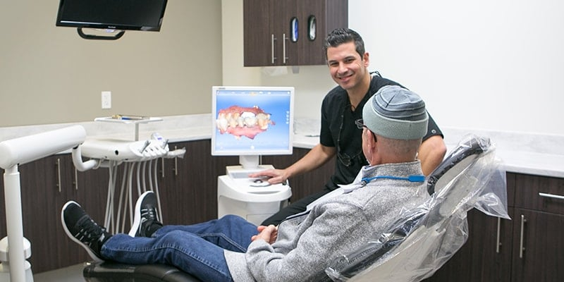 Dr. Youssef, an Edmonds dentist, working with an actual patient.