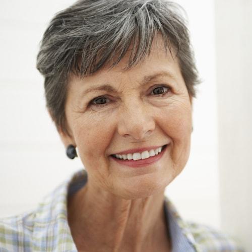 Dentist Edmonds WA - Older lady smiling after Oral Surgery